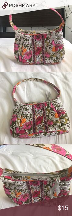Like-new Vera Bradley floral print purse This is a like-new Vera Bradley floral printed purse. It has pink, orange, green and white tones in it it has a zipper and a good amount of room on the inside. There are 4 pockets on the inside to put things in. There are also two side pockets on the outside. The bag can be put over the shoulder or on the forearm. Super cute and perfect for going out! No stains at all. Vera Bradley Bags Shoulder Bags