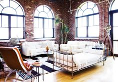 A Fresh, Layered Atlanta Loft// brick walls, vintage daybed