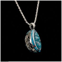 Ben Nighthorse, Diamond Flakes Pendant, 2 5/8 x 2 x 1/2 inches (actual), Sterling Silver, Turquoise, Coral, and Lapis. At the Gerald Peters Gallery, Santa Fe, NM.