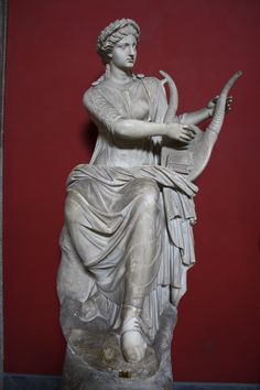 A Roman sculpture of Terpsichore, the Muse of Dance, playing a lyre, 1st century CE. (Vatican Museums, Rome).