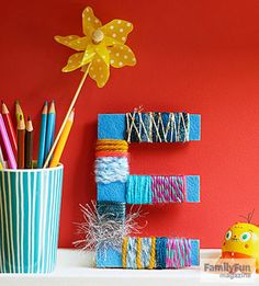 Spellbound: Kids can personalize a room with initials decorated with yarn scraps and felt.