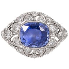4.50 Carat Art Deco Sapphire Diamond Platinum Ring. Genuine art deco splendor with a very finely detailed hand made platinum filigree mounting, set in the center with a 4.50 carat cornflower blue Ceylon sapphire. 38 old European cut diamonds weigh a total of .75 carats are peppered in nooks of filigree.  c 1925