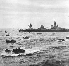 D-Day June 6th, 1944 - Landing craft passing the USS Augusta toward Omaha Beach