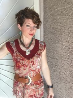 Type 3 red with paisley top and chinky belt. Curly pixie haircut.