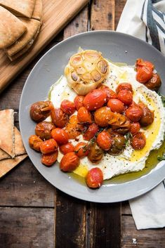 Whipped Feta with Roasted Garlic Tomatoes : Simple party appetizer recipe! This whipped feta recipe is topped with easy roasted garlic and blistered cherry tomatoes. The perfect appetizer recipe for entertaining and dipping sliced of pita bread. Whipped Feta, Snacks Sains, Cooking Recipes, Healthy Recipes, Quick Recipes, Crockpot Recipes, Appetizers For Party, Bread Appetizers, Roasted Garlic