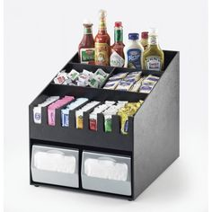 Classic Condiment Organizer: Looking for a way to be prepared to present toppings to feed an army without creating obnoxious amounts of clutter? This organizer is wide enough to be able to store two napkin dispensers  below the plethora of condiments. This is for you! www.calmil.com