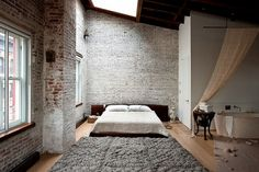 exposed brick, ahhh #openspaces http://www.nytimes.com/slideshow/2010/05/12/garden/20100513-rugs-slideshow-15.html