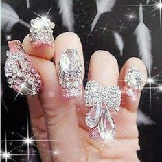 This is so excessive I had to repin it, just to show everyone how stupid this looked.  You couldn't do anything with that crap all over your nails!  I can't believe girls would actually do this.