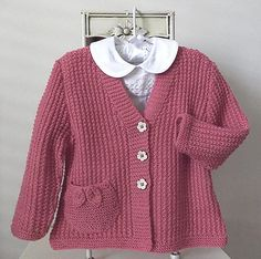 This sweet little girls V neck cardigan is great for the knitter who has mastered the art of knit and purl. The textured effect looks complicated, however is very easily achieved. The pocket/s with delicate leaves, adds that special bit of detailing.NOTE: THIS JACKET/CARDIGAN IS DESIGNED TO BE A GENEROUS FIT. IF YOU WANT A MORE FITTING STYLE YOU WILL NEED TO GO DOWN A SIZE.MATERIALS REQUIRED - PATONS BIG BABY 8ply yarn was used for the pictured garment.