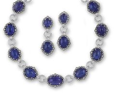A tanzanite and diamond necklace and pair of pendant earrings the necklace