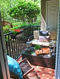 how cozy for our balcony-- a bench! Balcony Makeover by Erika Ward