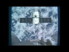The SpaceX Dragon capsule is grappled and berthed to the Earth-facing port of the International Space Station's Harmony module at 12:02 p.m. EDT, May 25, 2012.
