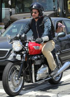 Let's hope he doesn't have a hangover! Bradley Cooper shows macho side by…