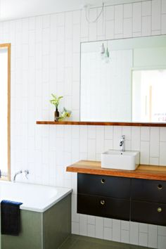Compact and clever renovated beach shack bathroom.