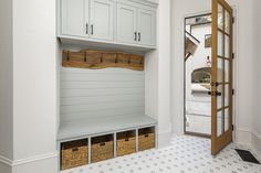 Charming mudroom features woven baskets placed on white and gray vintage hexagon floor tiles beneath a gray built-in bench. English Country House, House Design, Country House, Luxury Homes, Home, Built In Bench, Home Builders, Modern, Country House Design