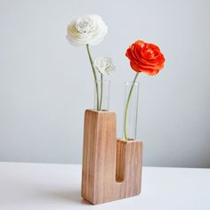Coal Power Plant Bud Vase Walnut vase, brown, accents. This Plant Bud Vase shows that there is beauty in imbalance. Two test tubes rest inside of recycled pieces of FSC-certified Baltic birch plywood that are finished with a walnut veneer. In this way, Sjotime provides an elegant interpretation of flower power.