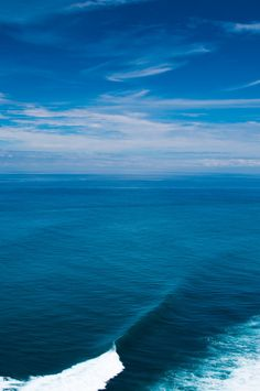 Into the Blue!! so peaceful You can barely tell where the sea stops and sky starts. Crazy beautiful.