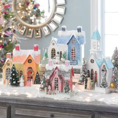 Christmas village this year with houses and churches in juicy shades of pink, lime and tangerine. As always, these folk art classics are made of painted heavy paper stock with mica glitter accents and bristle brush trees.