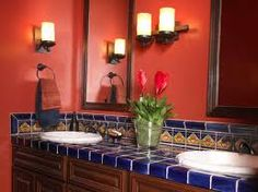 love the uplights, wall color, and cobalt blue hand painted mexican tile! Want to find tiles like these.
