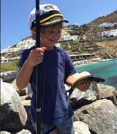 Such a Happiness! ALessandra's Ambrosio son, just caught a fish! Alessandra Ambrosio, Sons, Captain Hat, Happiness, Fish, Happy, Fashion, Moda, Bonheur