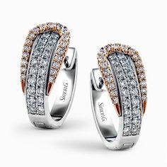 The modern design of these white and rose gold earrings is accentuated by ctw of glistening round cut white diamonds. Diamond Earing, Diamond Hoop Earrings, Rose Gold Earrings, Pendant Earrings, Diamond Studs, Diamond Jewelry, Jewelry Rings, Silver Jewelry, Men's Jewellery