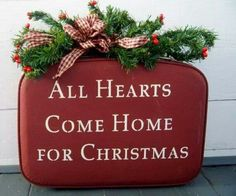 Cool Christmas idea, use one of the old style suitcases, paint it red add some greenery and letter the front:-)