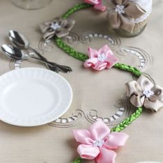 Hand sewn flowers that are attached to a braided ribbon vine. The perfect decoration to make a table feel feminine and girly.