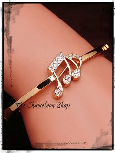 Lovely Gold Plated Music Note Bangle With Rhinestones. Starting at $5