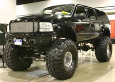 Jacked Up 2001 Ford Excursion.... :) now just remove the topper, add a hot pink browning buck, Badass on the tailgate, and farm girl on the sides. And my dream truck