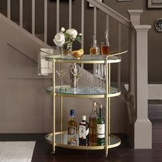 Home bars make drinks personal. Get home bar furniture including wood bars, fold-away bars, wine bar cabinets and more at Bed Bath & Beyond. Want a home bar cart? Buy now. Metal Bar Cart, Diy Bar Cart, Gold Bar Cart, Bar Cart Decor, Bar Carts, Bar Cart Styling, Mirror With Shelf, Glass Shelves, Bars For Home