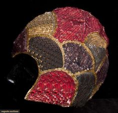 Augusta Auctions: Vintage evening skull cap, late 1920s. White cotton net completely covered in sequins worked in scallop edge shapes in shades of blue, pink, violet & silver, widow's peak, ivory cotton backing.