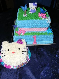 HELLO KITTY 1st birthday cake with personal cake for the birthday girl
