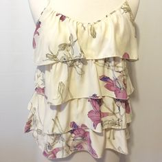 """Parker Cream & Lilac Print Silk Sleeveless  Top Femininity at it's best! Cream backed with lilica, lavender, soft olive and plum flowers. Fully lined in silk, four tiered of ruffles, adjustable Criss cross lingerie straps, elastic at back to ensure a secured fit. Worn once. 100% silk Dry Clean 36"""" bust 24""""overall length Parker Tops Blouses"""