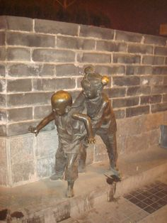 Statues near Gulou subway station, kids who play hide and seek - Photo by Adele Tang