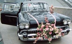 Cadillac with plenty of flowers