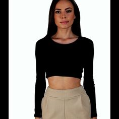 Coming soon reserve today! Tid long sleeve crop top!  So cute!  88% Tencil, 12% Spandex.  Very soft ribbed top.  Dressed up or down this top is sure to make everyone look!  High quality and made in L.A.  I have 2 small, 2 medium and 1 large coming.  Like to be notified when it they arrive or kept me know your size and reserve yours today! Tops Crop Tops