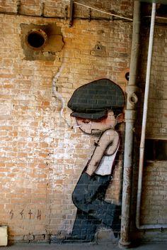 Un muchachito en la esquina de Beijing.