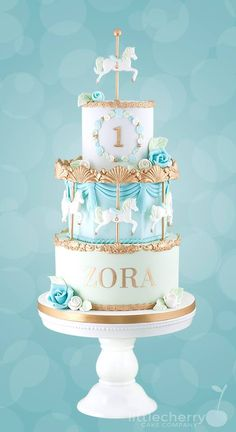 3 tier carousel cake in blue and green