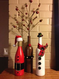 Santa, Reindeer, Snowman trio for the Holidays made from wine bottles.