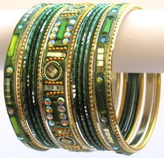 Beautiful Mehendi Green and Gold Indian Bangles Jewellery Belly Dance Stud Bracelet Set Product Code :Indian Bangles Set 30 The Bangles Set Contains 26 individual Bangles Colors & Design: (As Per Images) Quantity: 1 Bangles Set Base Material : Alloy Metal & Lac decorated with different stones and Kundan and Age Group : Adult,Kids Price $USD   11.95