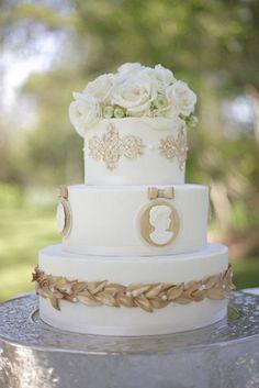 wedding cake adorned with cameos Photography by Shane Snider Photography / shanesnider.com/