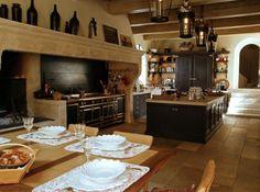 Kitchen - gorgeous french kitchen - La Cornue range - fireplace - large marble island - flagstone flooring - rustic beam | Méloni Brothers via Elle Maison