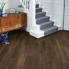 Make a bold statement with dark natural wood effect vinyl flooring. A range of options create a dramatic and striking style for your home. Vinyl Flooring Kitchen, Hallway Flooring, Wide Plank Flooring, Luxury Vinyl Flooring, Diy Flooring, Flooring Ideas, Wood Effect Floor Tiles, Hardwood Floor Colors, Light Hardwood Floors
