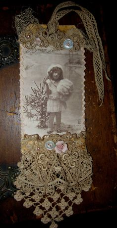 Vintage Lace Collage Edwardian Christmas Girl with Muff Embellished Tag. $16.99, via Etsy.