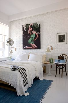 WHITE brick- love the look of this room, simple whites... maybe pull this off for the guest room
