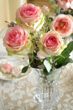 a rose is a rose. Pink rose arbor and pink house Pink roses