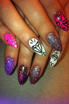 freaked out by the shape of her nails but diggin the designs!