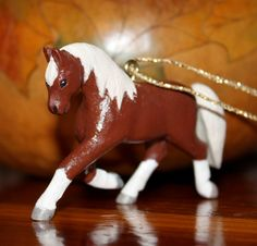 Items similar to Horse pendant with flaxen mane and tail and four white dancing feet! A real parade horse! Hand carved from birch and hand painted. on Etsy Carved Wooden Animals, Hand Carved, Hand Painted, Chestnut Horse, Mane N Tail, Christmas Gifts, Christmas Ornaments, Dancing, Dinosaur Stuffed Animal