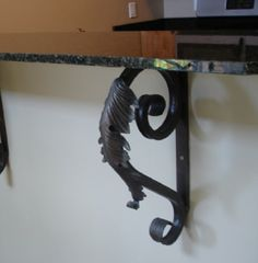 """Heavy Duty Iron Leaf Bracket is ideal for Granite or other heavy surface. Excellent choice for mantels as well. Handmade and measuring 11""""X19"""". Other sizes available. www.shorelineornamentaliron.com"""