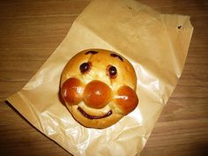 "Anpanman - Basically bread with chocolate filling in the shape of a Japanese superhero's face (literally translated ""bean jam filled bread man"")"